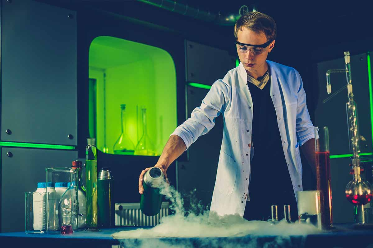 Photograph showing a student conducting a science experienment