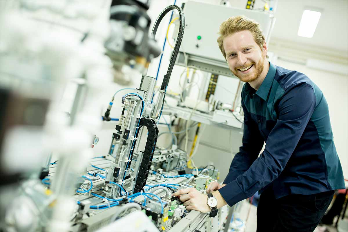 Photograph showing a man using a FESTO machine