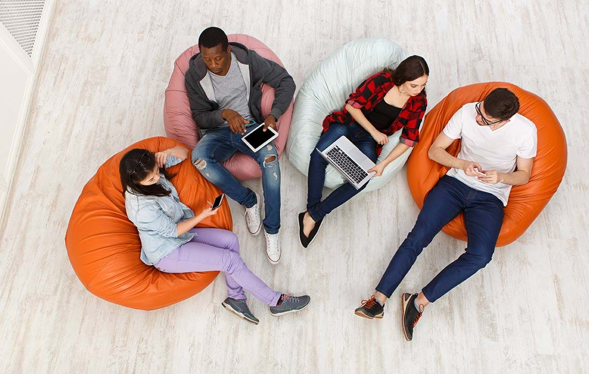Birdseye view photograph showing a group of four students relaxing in a common area