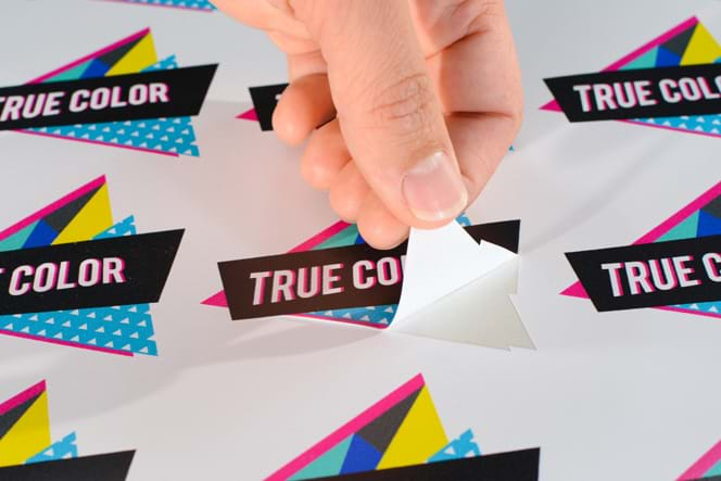 An image of someone pealing stickers.